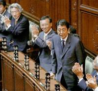Shinzo Abe acknowledges the congratulations of his peers in the House of Representatives, including silver-maned departing Prime Minister Junichiro Koizumi, Tuesday after they elected him the nation's new leader. | KYODO PHOTO