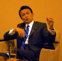 Foreign Minister Taro Aso speaks to reporters in Tokyo Wednesday, the day after his reappointment. | REIJI YOSHIDA PHOTO