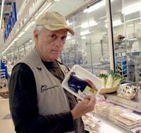 Animal rights activist Ric O'Barry, who once trained dolphins for the popular 1960s U.S. TV series 'Flipper,' holds up a package of dolphin meat at a supermarket here on Thursday. | BOYD HARNELL PHOTO