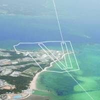The planned U.S. Marine Corps airstrip that extends offshore from Camp Schwab near Nago will have two runways forming a V. The dotted lines show the currently approved approach paths.   KYODO PHOTO