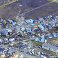 MEMANBETSU, Hokkaido -- Saroma, Hokkaido, is strewed with rubble Wednesday in the wake of the tornado that ripped through the town the previous day, killing nine people. Story on Page 2   KYODO PHOTO