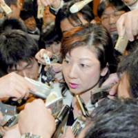 Lawmaker Seiko Noda answers questions from reporters Monday at Liberal Democratic Party headquarters after she was allowed to rejoin the LDP.   KYODO PHOTO