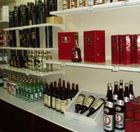 Bottles of imported liquor line the shelves of a shop at the Koryo Hotel in Pyongyang. | KYODO PHOTO