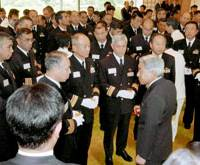 Emperor Akihito chats with Self-Defense Forces officers Thursday at a dining hall in the Imperial Palace in Tokyo.   POOL PHOTO