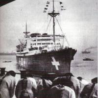 Relatives of four of the six Japanese sailors killed in the midget submarine raid on Sydney Harbour in 1942 greet the Kamakura Maru as it arrives at Yokohama with the ashes of the four submariners. | SHASHIN SHUHO FILE PHOTO