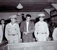 Masaru Okunishi appears in his first trial session on June 16, 1961, in connection with the slaying of five people and injury of 12 others, all of whom drank wine he allegedly poisoned at a gathering in Nabari, Mie Prefecture, earlier that year. | KYODO FILE PHOTO