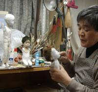 Doll Maker Yuki Atae makes a doll's face in his workshop in Tokyo. | KYODO PHOTOS