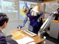 A robot serves a cup of tea during a demonstration at the University of Tokyo last week. | KYODO PHOTO