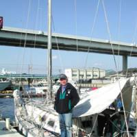 Seven-time solo circumnavigator Minoru Saito pauses from repair work on his sloop, Shuten-dohji II, Jan. 27 to wax about his latest quest, Challenge 8, dockside in Yokohama. | ERIC L. DUE PHOTO