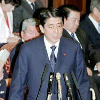 Prime Minister Shinzo Abe speaks Monday in a House of Councilors Budget Committee session. | KYODO PHOTO
