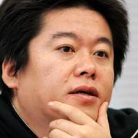 Takafumi Horie collects his thoughts in this file photo taken last Dec. 20.   AP PHOTO