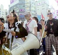 Part-Timers take part in a rally in Shinjuku Ward, Tokyo, on Monday to call for better working conditions after gathering for a meeting of their labor union. | KYODO PHOTO