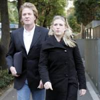 Lucie Blackman's sister, Sophie, and father, Tim, walk outside the Tokyo District Court on Dec. 2, 2004, to meet with prosecutors. | AP PHOTO