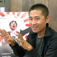 Kazuhiro Soda, director of the documentary 'Campaign,' talks about the film in Tokyo last month. | SATOKO KAWASAKI PHOTO