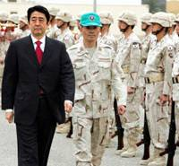 Prime Minister Shinzo Abe inspects Air Self-Defense Force troops at the Ali Al-Salem Air Base on the outskirts of Kuwait City on May 1. | AP PHOTO