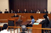 Six lay judges and three professional judges (center) sit on the bench for a 'saibanin' (lay judge) mock trial held May 30 to June 1 at the Tokyo District Court. | YOSHIAKI MIURA PHOTO