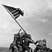 U.S. Marines of the 28th Regiment, 5th Division, raise the American flag atop Mount Suribachi on Feb. 23, 1945, during the Battle of Iwojima. The island was renamed Iwoto last week.   AP PHOTO