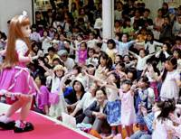 Children celebrate the 40th anniversary of the popular dress-up doll Licca-chan in Tokyo's Ikebukuro district in May. | KYODO PHOTO