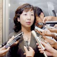 Former posts and telecommunications minister Seiko Noda faces reporters Friday after the Lower House plenary session.   KYODO PHOTOS