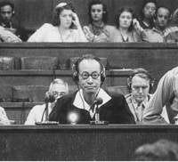 Hajime Satomi, who headed an opium-dealing operation in China during the war that bankrolled the Japanese military and puppet governments in China, testifies during the Tokyo war crimes tribunal on Sept. 4, 1946.   KYODO PHOTO