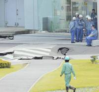 A road inside the Kashiwazaki-Kariwa nuclear plant was severely damaged by the July 16 temblor. | AP PHOTO/KYODO