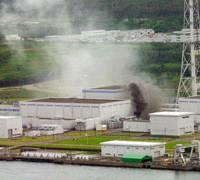 Black smoke spews from a burning electrical transformer near one of the Kashiwazaki-Kariwa nuclear plant's seven reactors after a fire broke out following the July 16 earthquake that hit Niigata Prefecture and closed the complex. | AP PHOTO