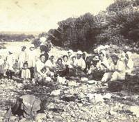 Shohei Yamamoto (far left), poses for a photo at around age 5 during a riverside picnic with fellow islanders in the village of Shana on Etorofu Island around 1933. | PHOTO COURTESY OF SHOHEI YAMAMOTO