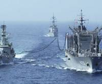A maritime Self-Defense Force supply vessel (right) provides fuel to a Pakistani warship in September in the Indian Ocean. | MSDF PHOTO / KYODO