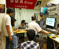 Members of Burma Democratic Action at their office in Takadanobaba, Tokyo, interview democracy activists in Myanmar for their Internet news program. | KYODO PHOTO