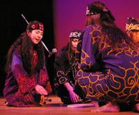 Mina Sakai (left) and other members of the Ainu Rebels in traditional Ainu costumes perform in Hanno, Saitama Prefecture, earlier this month. | KYODO PHOTO