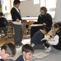 Second-graders at K. International School Tokyo in Koto Ward study during a class in December. | AKEMI NAKAMURA PHOTO