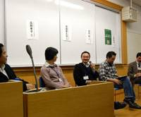 Panelists (from left) Takashi Fukui, Takako Takano, Hisashi Sonehara, Tsuyoshi Sekihara and Toshimichi Hirose discuss eco-tourism and how it can help energize communities during a symposium at the National Olympics Youth Memorial Center in Yoyogi, Tokyo, last week. | KAZUAKI NAGATA PHOTO