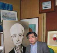 Takehiko Hirasawa, 49, talks about his struggle to clear the name of his late adoptive father, Sadamichi, at his home in Tokyo, surrounded by the latter's paintings. | KYODO PHOTO