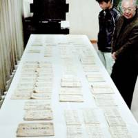 Documents from the 18th century explaining how delegations from the shogunate should be handled are shown to reporters in Chizu, Tottori Prefecture.   KYODO PHOTO