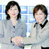 Liberal Democratic Party lawmakers Seiko Noda (left) and Yukari Sato attend a news conference Friday at LDP headquarters in Tokyo. | KYODO PHOTO