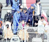 Relatives of missing fishermen Haruo Kichisei and his son, Tetsuhiro, visit the area on Saturday where the collision between their boat and the destroyer Atago occurred Tuesday, on a Maritime Self-Defense Force vessel off Chiba Prefecture.   KYODO PHOTO