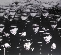 Tota Kaneko (third from left in back row) poses for a photo with fellow students at the Imperial Japanese Navy's Naval Paymasters School in Shinagawa, Tokyo, in winter 1943, then in the Truk Islands around August 1944. | PHOTOS COURTESY OF TOTA KANEKO