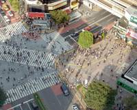 Pedestrians cross one of Tokyo's most crowded intersections near JR Shibuya Station last Sept. 25. | YOSHIAKI MIURA PHOTO