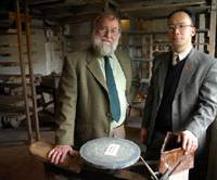 John Leach, the oldest grandson of famous British potter Bernard Leach, and Tomoo Hamada, grandson of Japanese ceramicist Shoji Hamada, pose at the Leach Pottery studio in St. Ives, England, in this undated photo. | PHOTO COURTESY OF REBECCA PETERS / KYODO