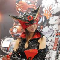 A model poses Saturday as Doronjo, a character from the popular animated cartoon 'Yattaman,' at the Tokyo International Anime Fair 2008.