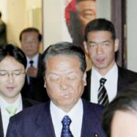 Ichiro Ozawa, Democratic Party of Japan chief, heads to a Tuesday meeting at DPJ headquarters in Tokyo. | KYODO PHOTO