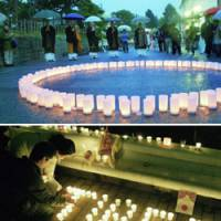 People in Nagano (top) and Tokyo (above) show their support for Tibet at events held Sunday evening.  A circle of candles was lit at Nagano's Zenkoji Buddhist temple, the starting point for the Olympic torch relay set for April 26, while a candlelight march was held in Tokyo's Shibuya Ward calling for peace in Tibet. | KYODO PHOTOS