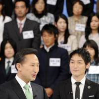 Catch them young: South Korean President Lee Myung Bak shares a light moment Monday with TV celebrity Tsuyoshi Kusanagi on a talk show with more than 100 young people. | AP
