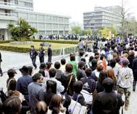 Hottest ticket in town: Hundreds of people seeking gallery seats for a retrial involving the 1999 murder of a mother and her baby daughter line up in front of the Hiroshima High Court on Tuesday morning. | KYODO