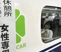 Snoozing bullet: A woman rests early Wednesday in a bullet train parked at JR Shin-Osaka Station to provide sleeping space for passengers delayed by an apparent suicide on the Tokaido Shinkansen Line. | KYODO PHOTO