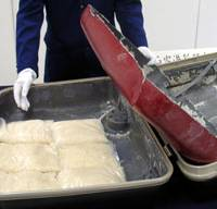 Big haul: A 7-kg stash of amphetamines that was found concealed in a modified suitcase is displayed to the media Friday at Kansai International Airport in Osaka Prefecture. | KYODO PHOTO