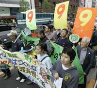 In support of peace: Demonstrators march and sing in support of Article 9 of the Constitution on a street in Tokyo Saturday. | AP PHOTO