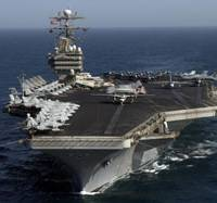 Showing the flag: The USS George Washington operates recently in the Persian Gulf. The nuclear-powered aircraft carrier is coming to Yokosuka, Kanagawa Prefecture, in August. | AP PHOTO