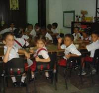 The beginning: Schoolchildren attend a Havana elementary school in October 2004. All education in Cuba has been state-directed and free since 1961. | HIROKO NAKATA PHOTO