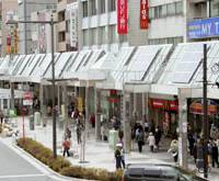 Sunny outlook: The Sugamo shopping arcade in Toshima Ward, Tokyo, boasts nearly 200 solar panels that provide about 10 percent of the mall's electricity needs. | KYODO PHOTO